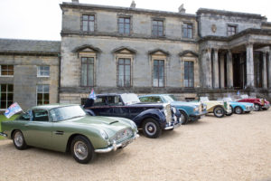 Classic c ars in front of country estate