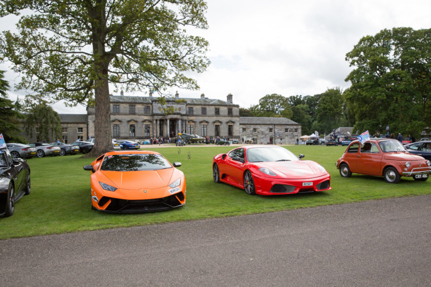 supercars in front of country estate