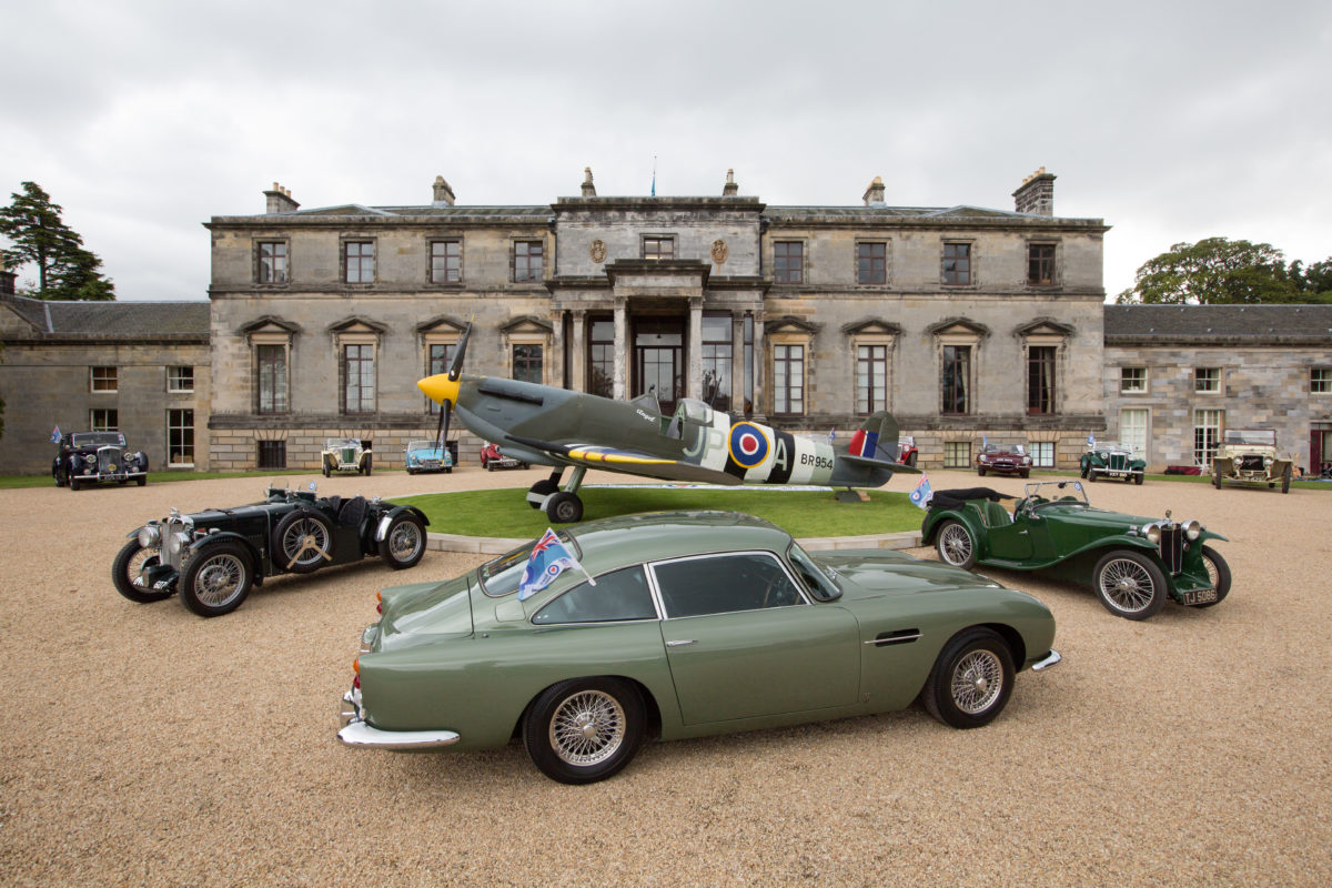 classic cars and spitfire in front of country estate