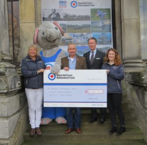 4 people and elephant mascot with a giant cheque for £15k